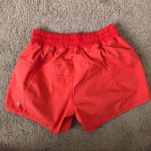 """lululemon athletica Shorts - Lululemon Orange Tracker Short V 4"""" Shorts"""